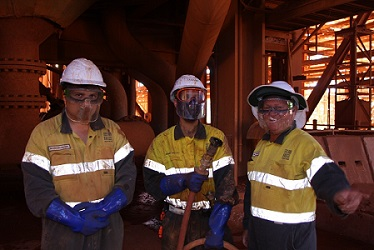 Mitchell Walsh, Shannon Weston and Forrest Personnel Supervisor, Michael English under the bauxite grinding mills