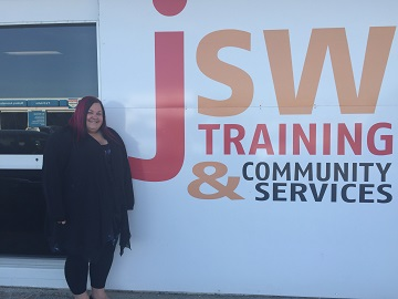 Picture of Kristy standing in front of the JSW building