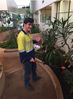Nic watering the gardens at Worsley South32
