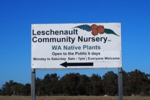 Highway sign that says Leschenault Community Nursery, WA native plants with a directional arrow
