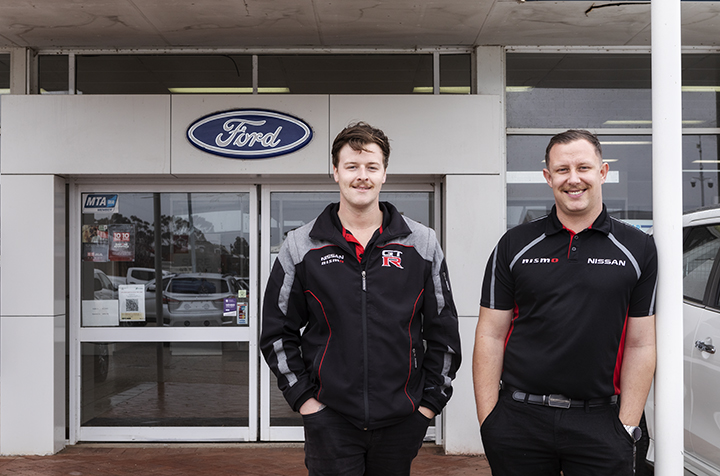 Two men standing out side the Narrogin Auto Centre
